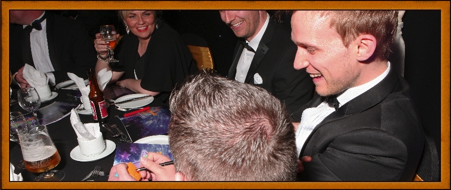 Nottingham Magician Atlas Brookings mingles with guests at a party